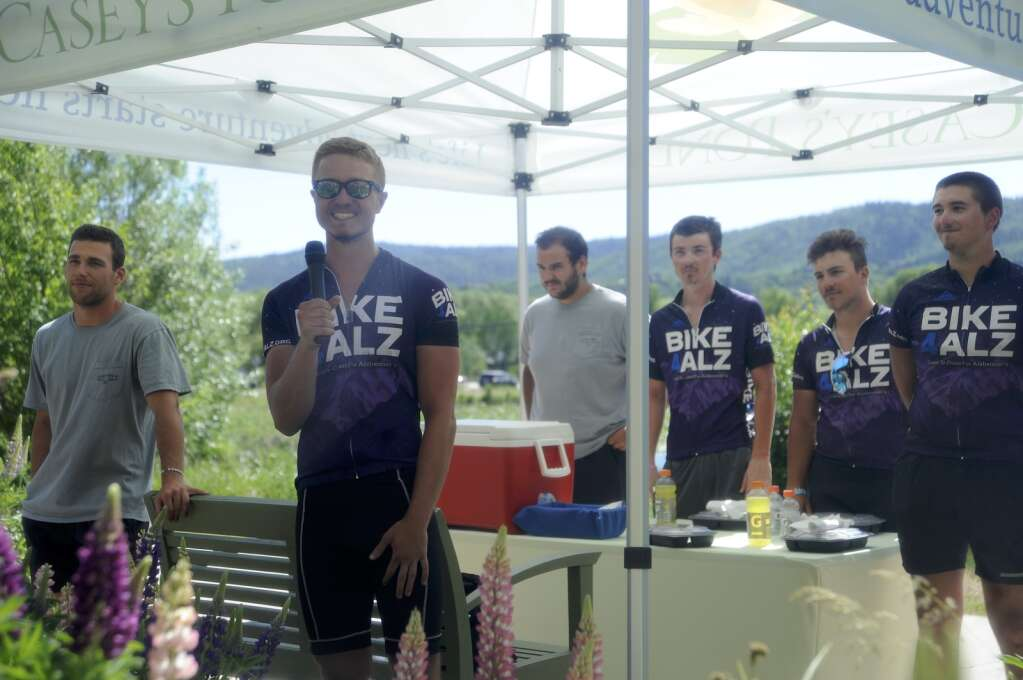 Justin Geilear addresses residents at Casey's Pond on Monday. He is one of 14 college students who are cycling across the country with Bike 4 Alz to raise money for Alzheimer's research. (Photo by Shelby Reardon)