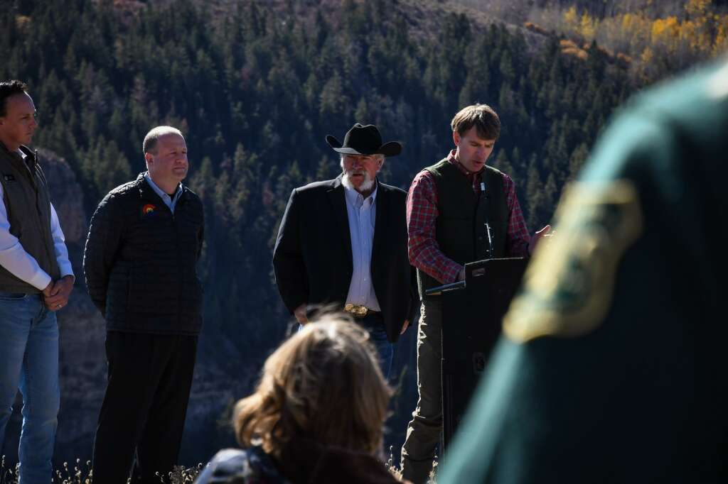 Colorado Department of Natural Resources Executive Director Dan Gibbs addresses the audience and members of the press during Wednesday's press conference at Sweetwater Lake. |Chelsea Self/Post Independent
