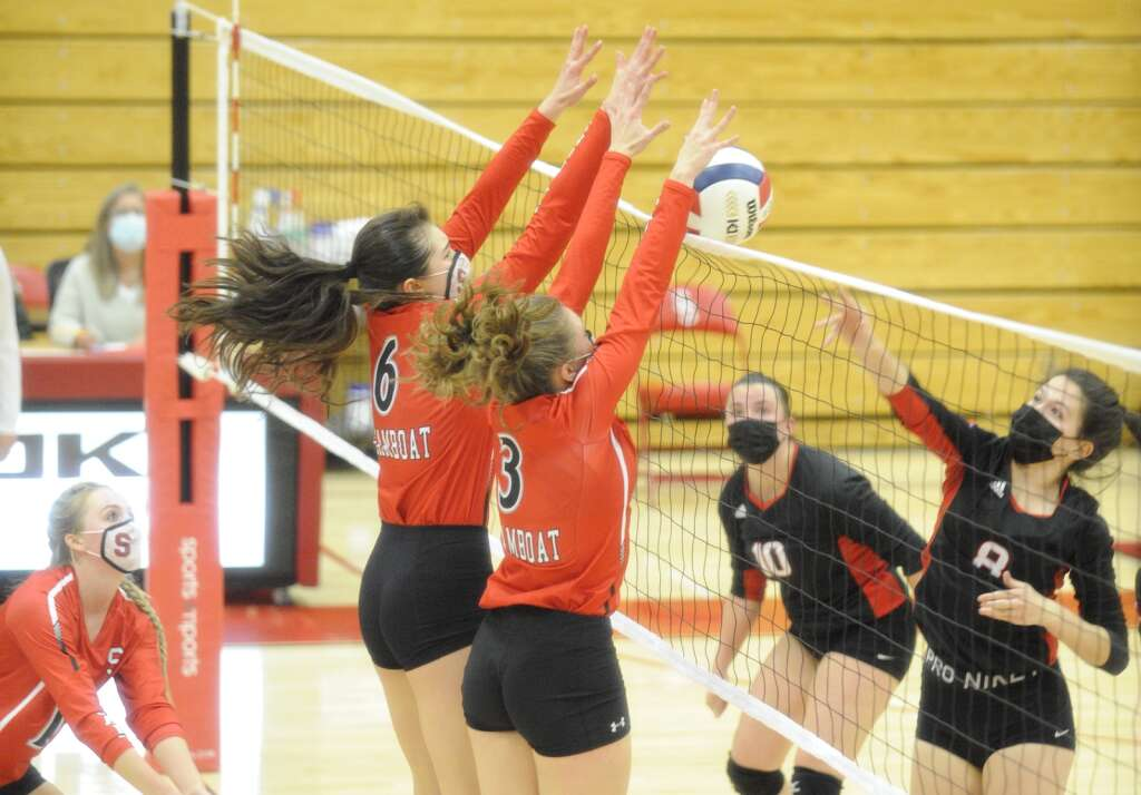 Steamboat's Aliyah Reimer and Emily Schnieder block a shot from Aspen's Sofie Durham during a game against Aspen on Thursday night. (Photo by Shelby Reardon)