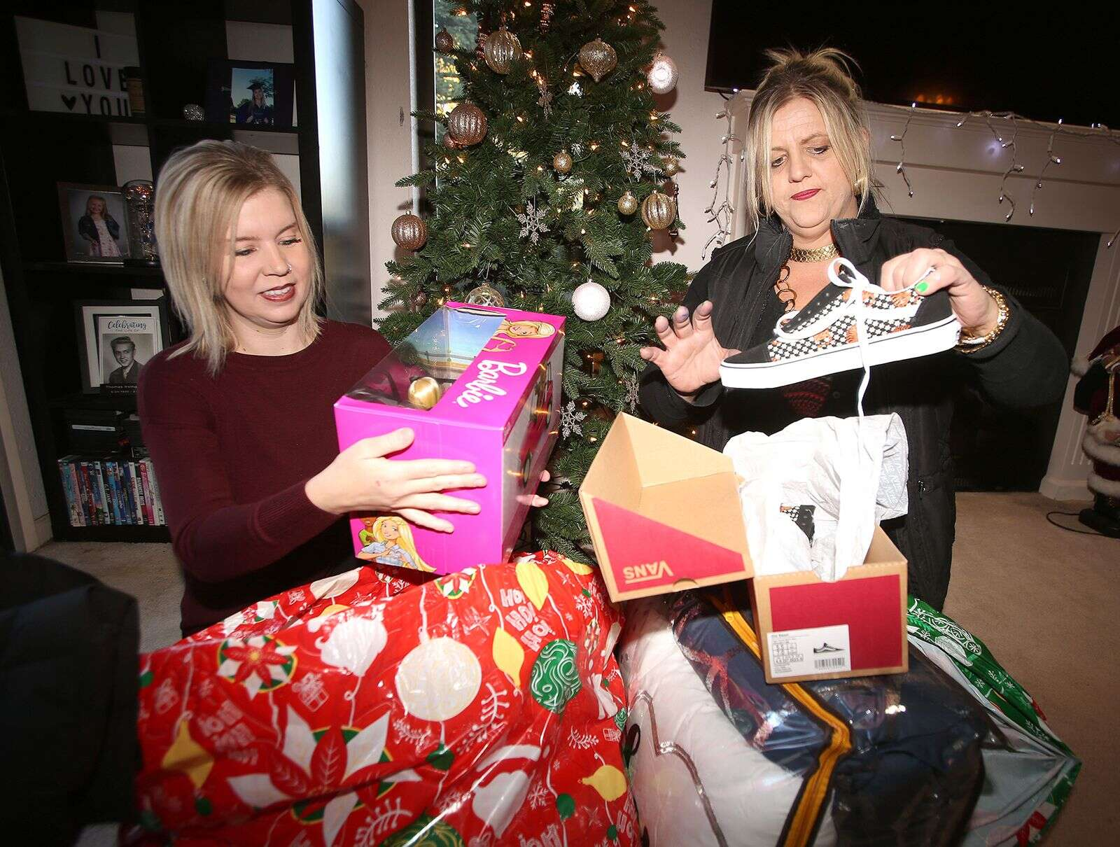 Savannah's Angels co-founders Crystal Grauke (left) and Cynthia Prout show off bags full of gifts slated for children in the community this year. The two are looking for some last minute angels to help out with some families in need this holiday.   Photo: Elias Funez