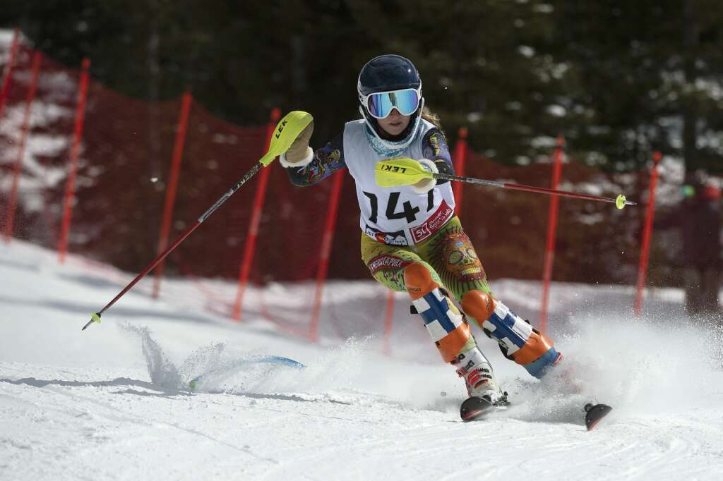 Evergreen High School Alpine ski team racer Sophie Morgan navigates gates while skiing the slalom course during the Colorado High School State Alpine Ski Championships at Loveland Ski Area on Friday, March 12, 2021.   Photo by Jason Connolly / Jason Connolly Photography
