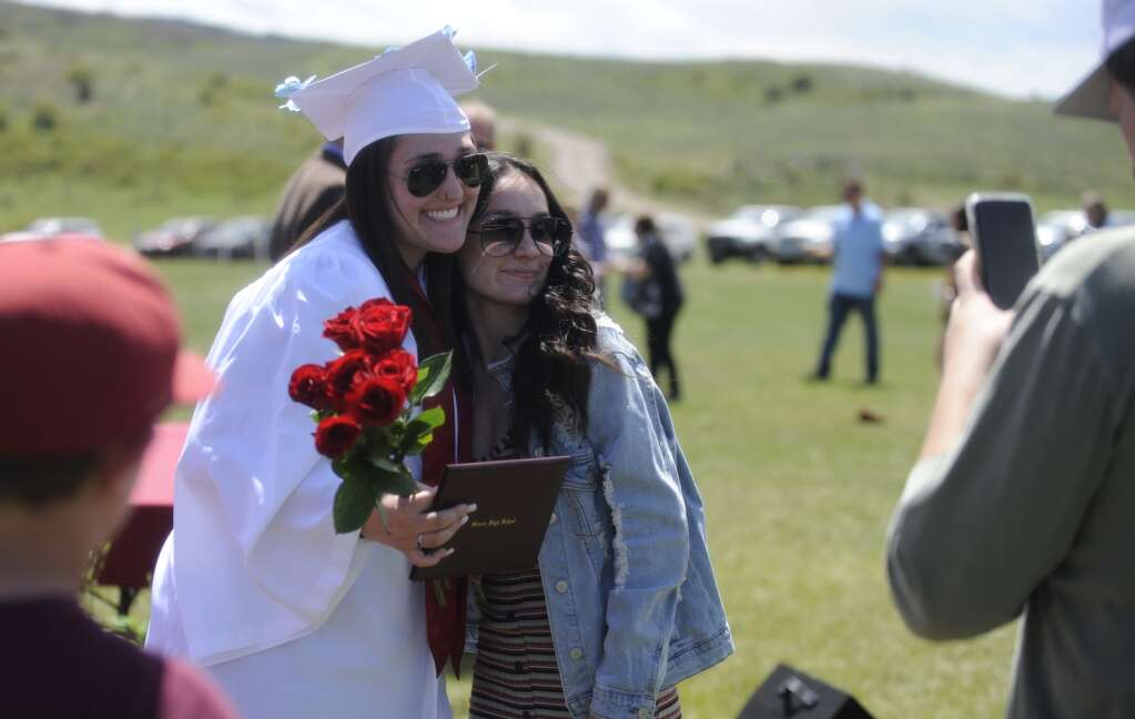 Dakota Barnhill poses with friends and family after the Soroco High School graduation ceremony on Saturday morning.