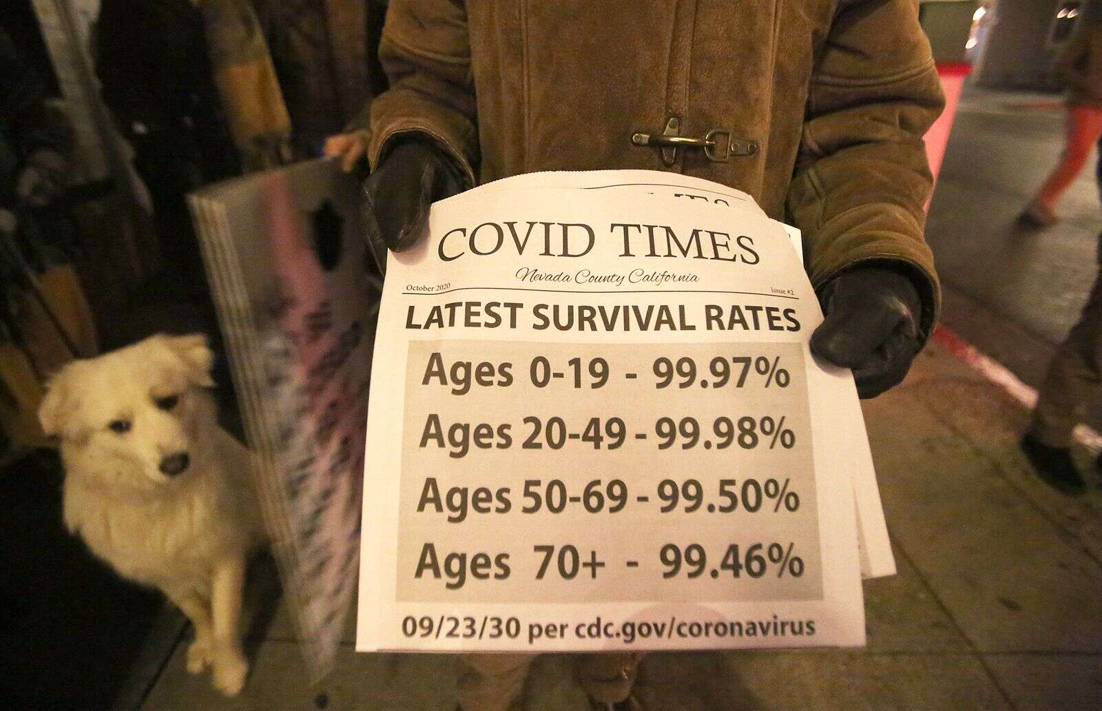A copy of the Covid Times, a Nevada County independent publication, is distributed during Friday's Nevada City Revival protest of the regional stay at home orders.