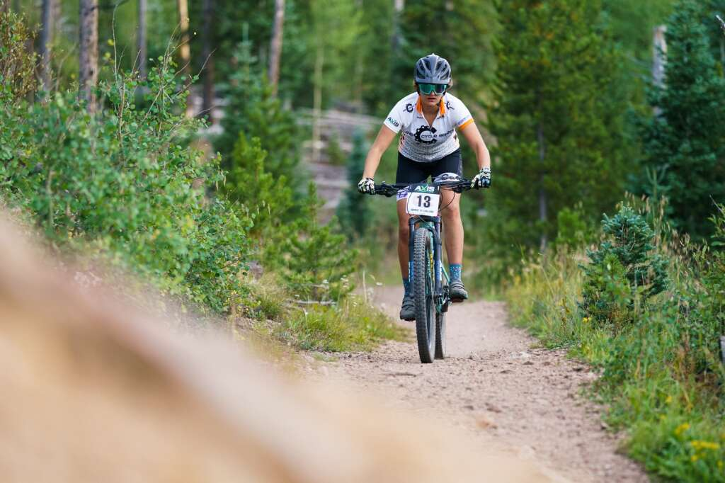 Junior expert category racer Abby Anderson stays focused on the trail as she speeds to a first-place finish in the Peaks Trail Time Trial. | Photo by John Hanson