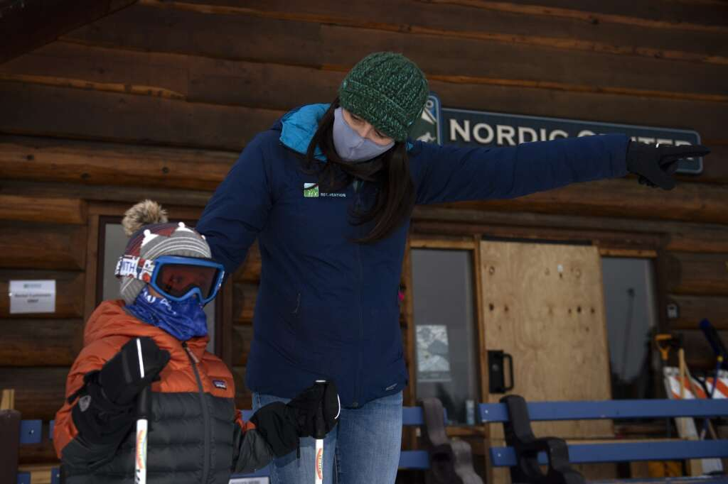 Frisco Fun Club Recreation Program Coordinator Sara Skinner instructs a student in the after-school Little Vikings Nordic ski program at Frisco Nordic Center on Monday, Jan. 25.   Photo by Jason Connolly / Jason Connolly Photography