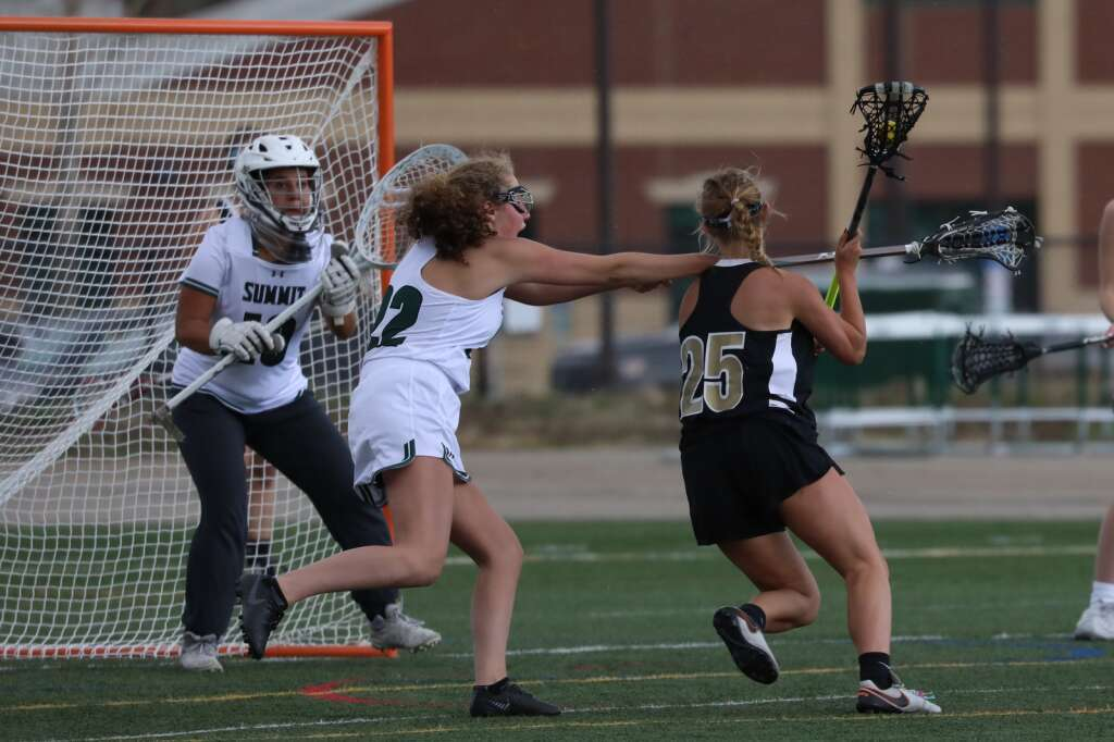 Summit High School junior Avey Riberdy defends during the girls varsity lacrosse team's season opener vs. Battle Mountain on May 8 in Breckenridge. | Photo by Ashley Low / Ashley Low Photography