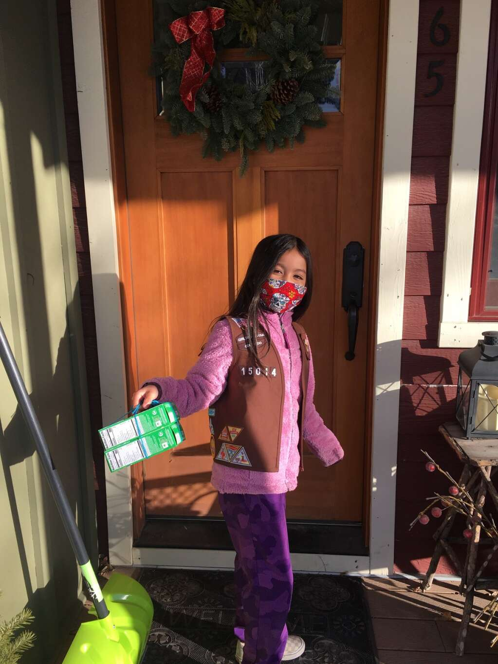 Aspen Girl Scout Cece Yang, 9, delivers boxes of cookies to a customer. | Kathy Yang/Courtesy image