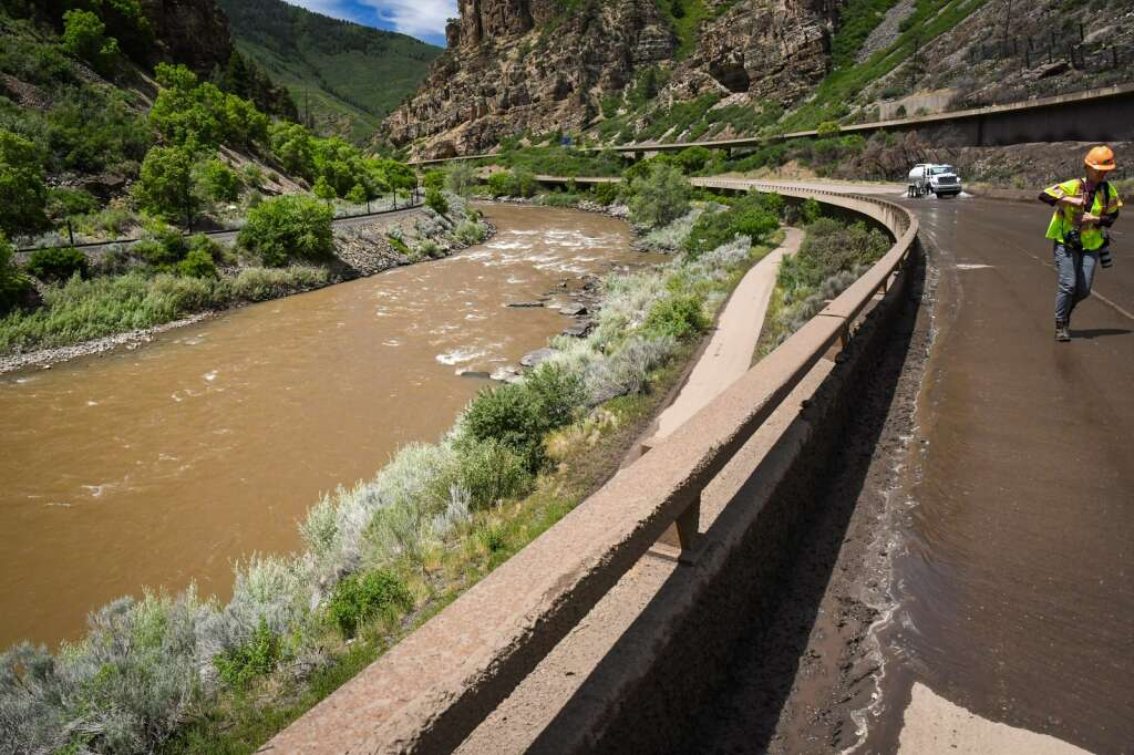 Crews make progress cleaning up the lower eastbound decks of Interstate 70 near MM120 after a mudslide swept down the cliffs in Glenwood Canyon in the area of the Grizzly Creek burn scar on Sunday. |Chelsea Self / Post Independent