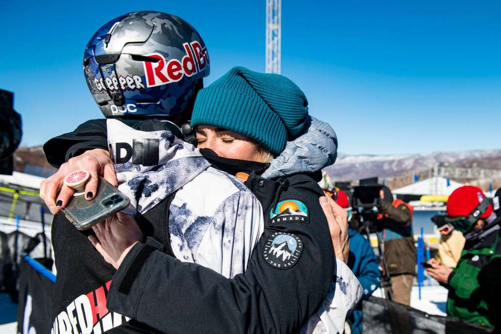"""X Games 2021 men's ski slopestyle gold medalist Nick Goepper and his wife Lizzy Goepper share a moment after the finals at the base of the course at Buttermilk on Sunday, Jan. 31, 2021. """"I'm on Cloud 9,"""" said Lizzy about her husband's gold medal. """"He's worked so hard this year. He deserved this more than anyone I know."""" (Kelsey Brunner/The Aspen Times)"""