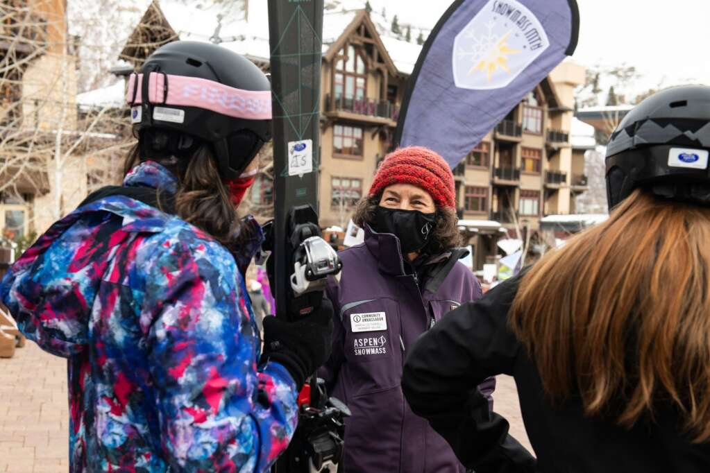 Mary Lou Farrell talks with visiting skiers next to the Elk Camp Gondola in Snowmass Base Village on Tuesday, Jan. 26, 2021. (Kelsey Brunner/The Aspen Times)