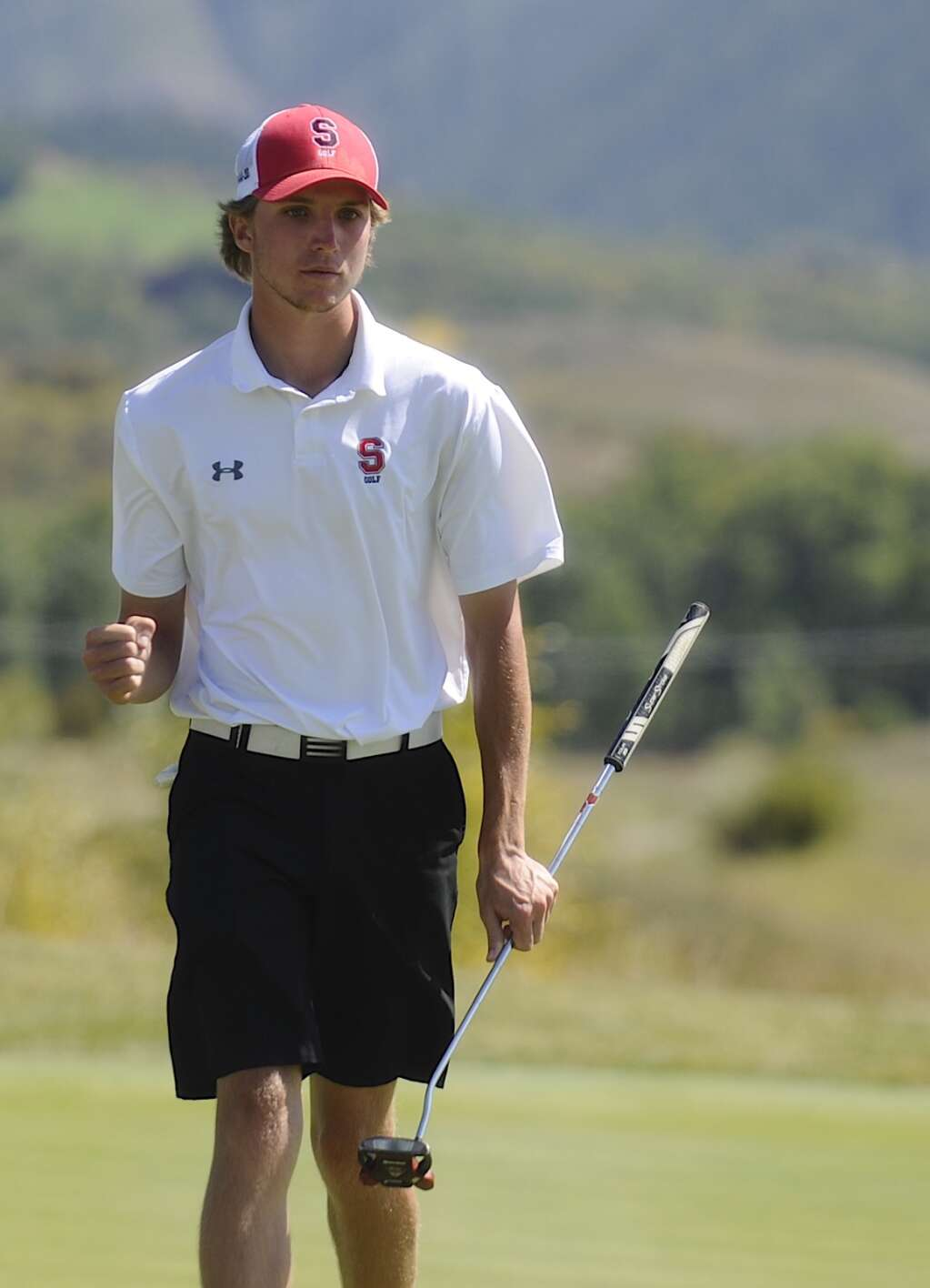 Steamboat Springs senior golfer Travis Seitz pumps his fist after putting at the Steamboat Sailor Invitational at Haymaker Golf Course on Tuesday. | Shelby Reardon/Steamboat Pilot & Today