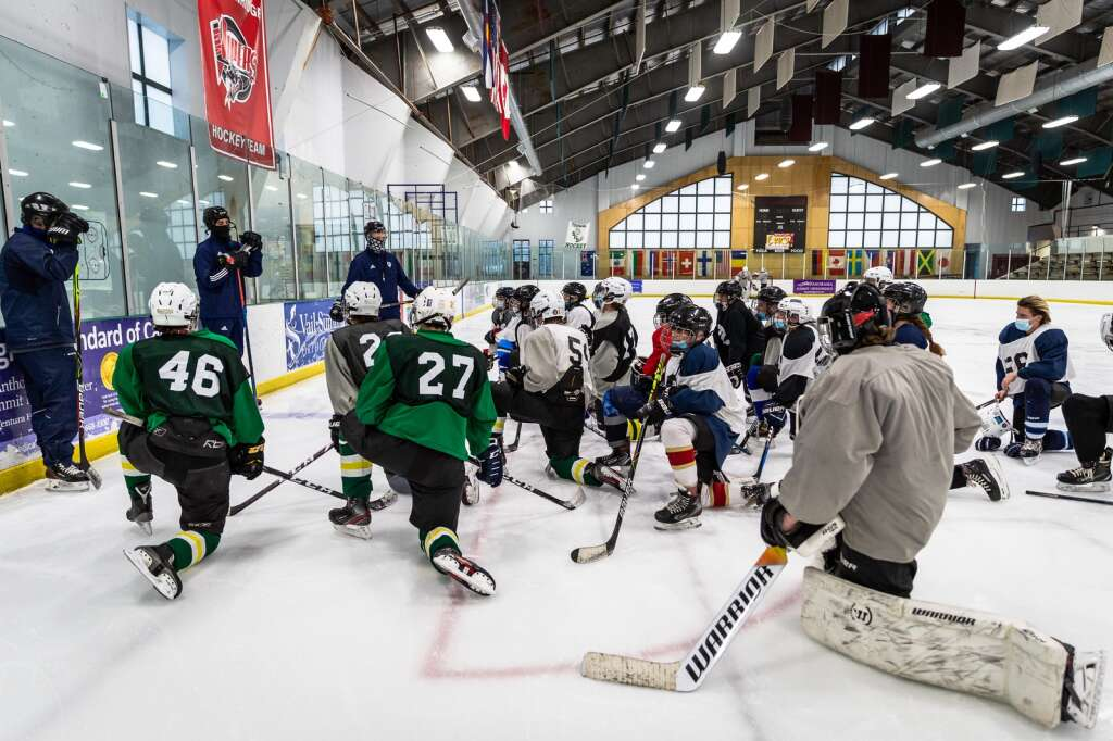 Head coach JR Engelbert, left center, works with the Summit High School hockey team Thursday, Jan. 21, during practice at Stephen C. West Ice Arena in Breckenridge. Assistant coaches Ian McCluskie, left, and Josh Schneider, right, also are pictured. | Photo by Liz Copan / Studio Copan