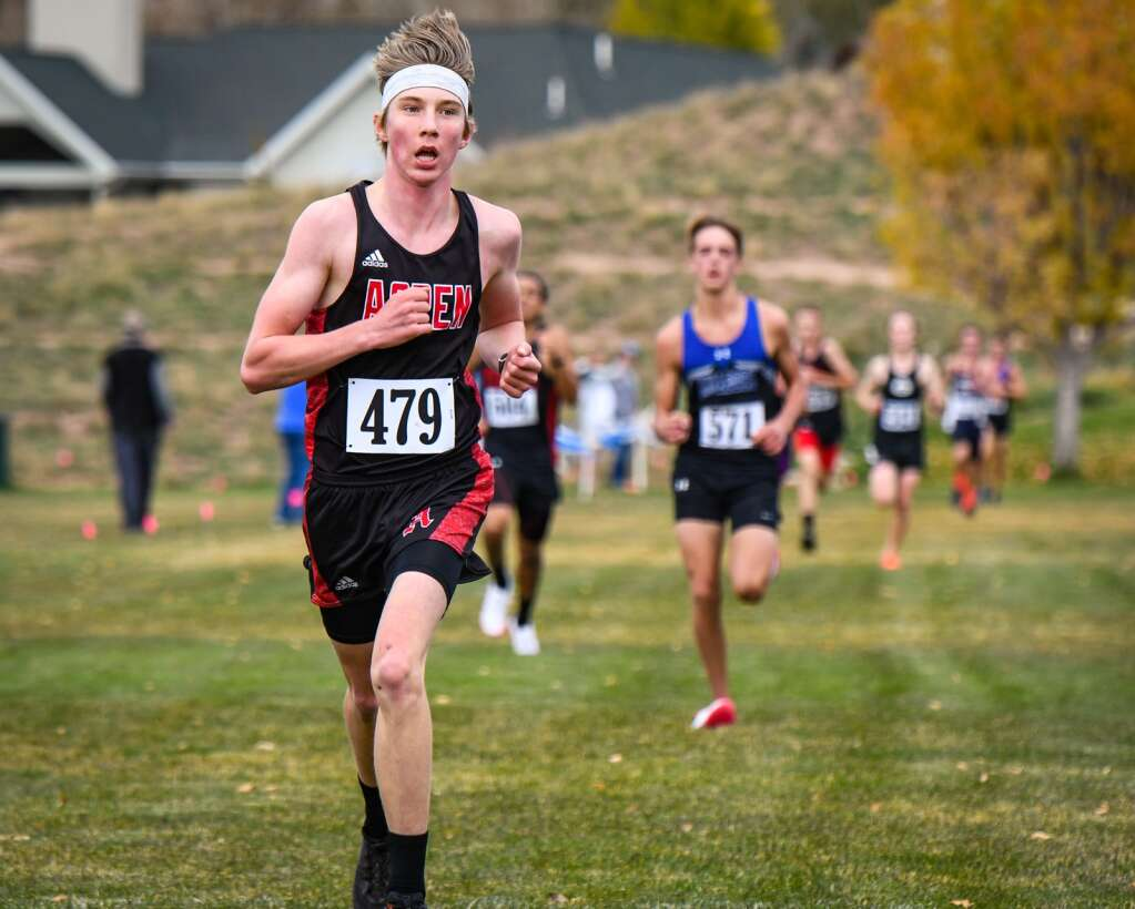 Aspen High School runner Eske Roennau crosses the finish line at Friday's Colorado 3A Region 1 XC meet at VIX Park in New Castle.   Chelsea Self/Post Independent