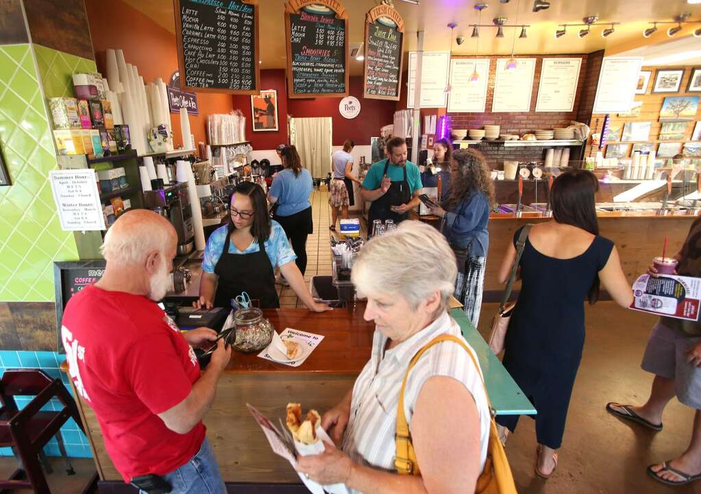 Customers and employees at Valentina's Organic Bistro & Bakery in Grass Valley's Glenbrook Basin, go about their daily business without face coverings Friday morning despite an order from the Nevada County Environmental Health Department. | Photo: Elias Funez