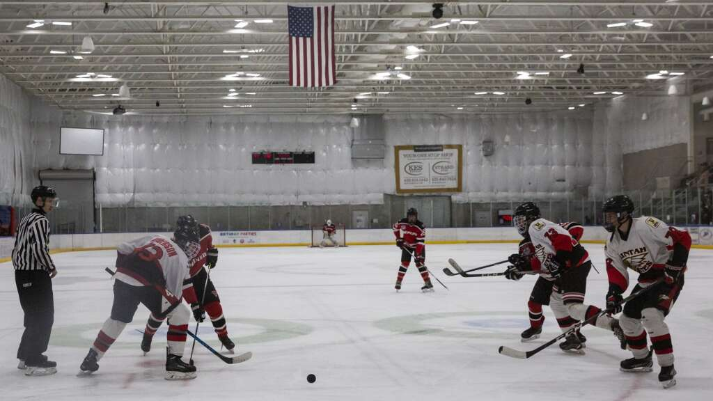 The Park City High School hockey team faces off against Uintah High School at the Park City Ice Arena Saturday evening, Sept. 25, 2021. The Miners defeated the Utes 6-0. (Tanzi Propst/Park Record)