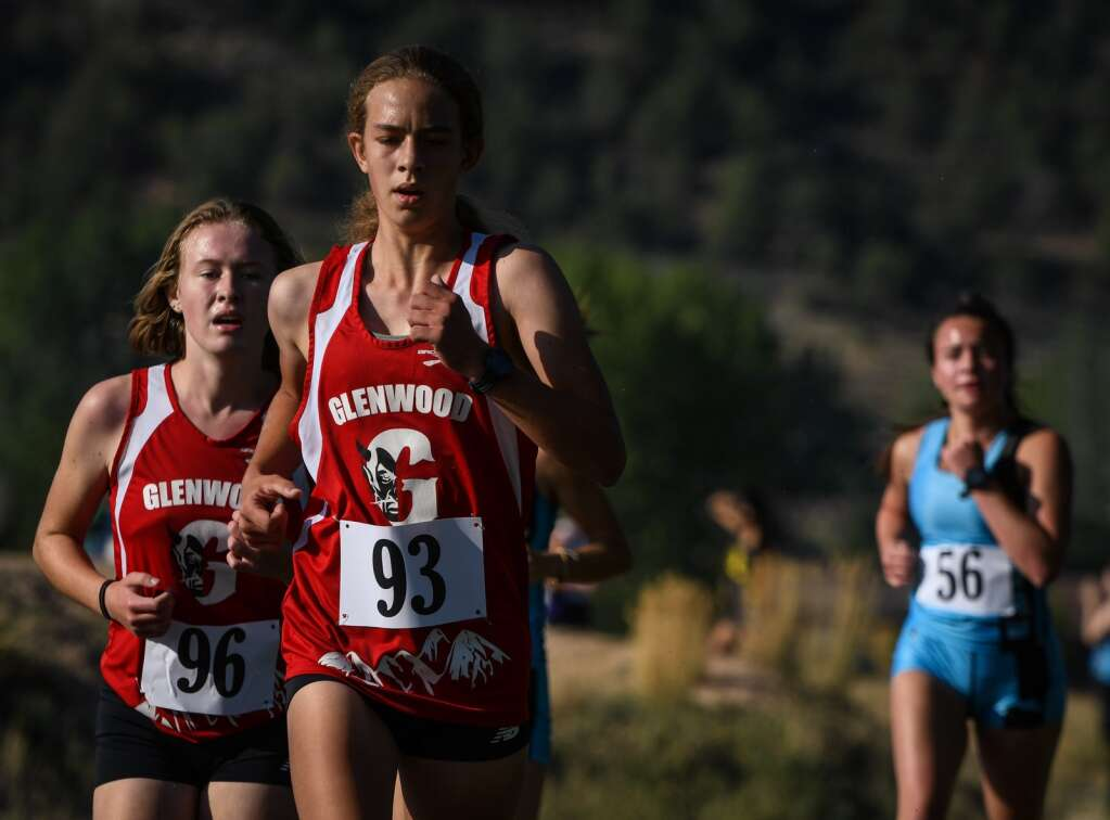 Glenwood Springs High School cross country runners Alexa Helms and Alicia Lowe compete in Friday's meet hosted by Coal Ridge at VIX Park in New Castle. |Chelsea Self / Post Independent