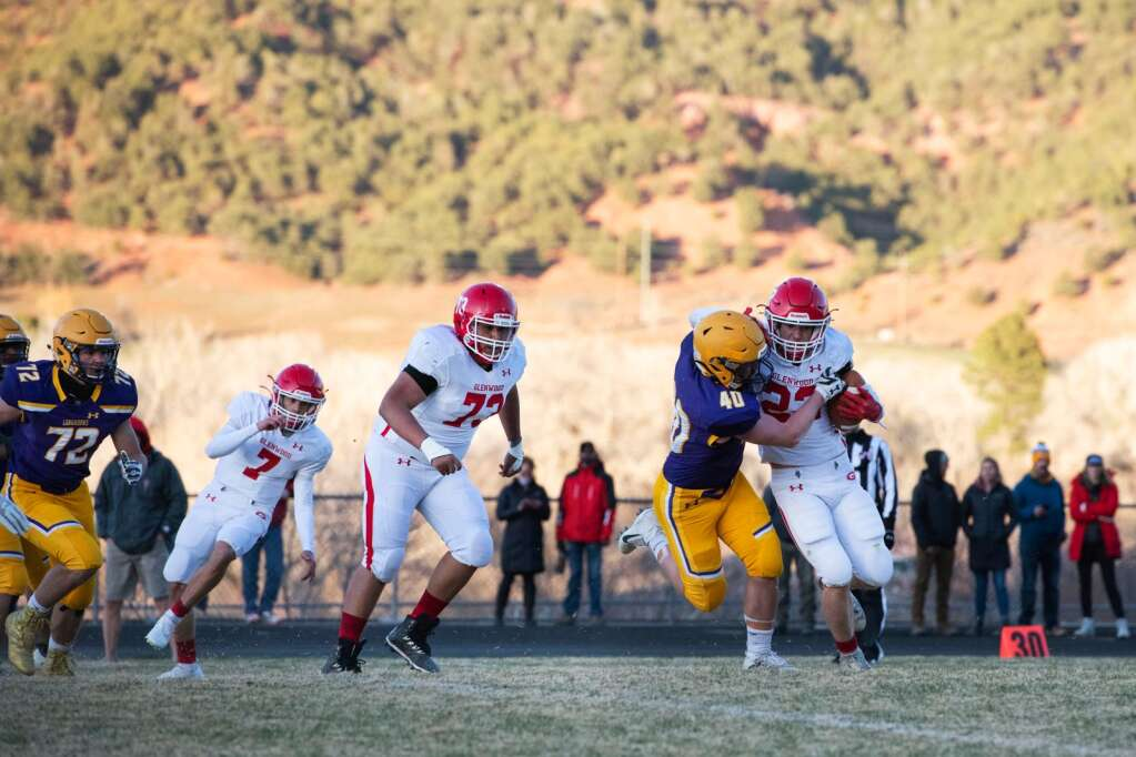 Basalt High School's Trevin Beckman attempts to tackle Garrett Dollahan as he runs the ball during the first half of the homecoming game at Basalt on Friday, April 9, 2021. (Kelsey Brunner/The Aspen Times)
