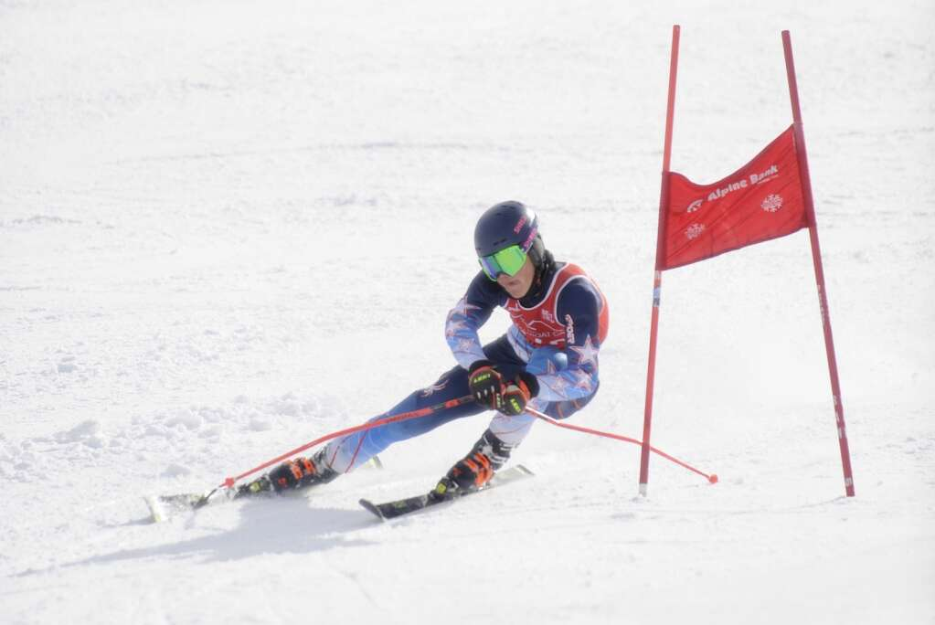 Steamboat Springs senior Alden Wade sticks out his tongue while skiing GS at the state skimeister championships at Howelsen Hill on Tuesday, March 9.