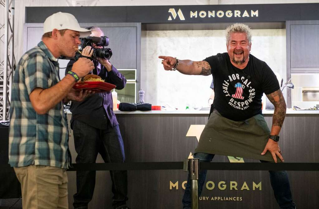Guy Fieri points out an audience member who took a large bite out of his prepared vegan burger after his morning seminar at the Food & Wine Classic in Aspen on Saturday, Sept. 11, 2021. (Kelsey Brunner/The Aspen Times)