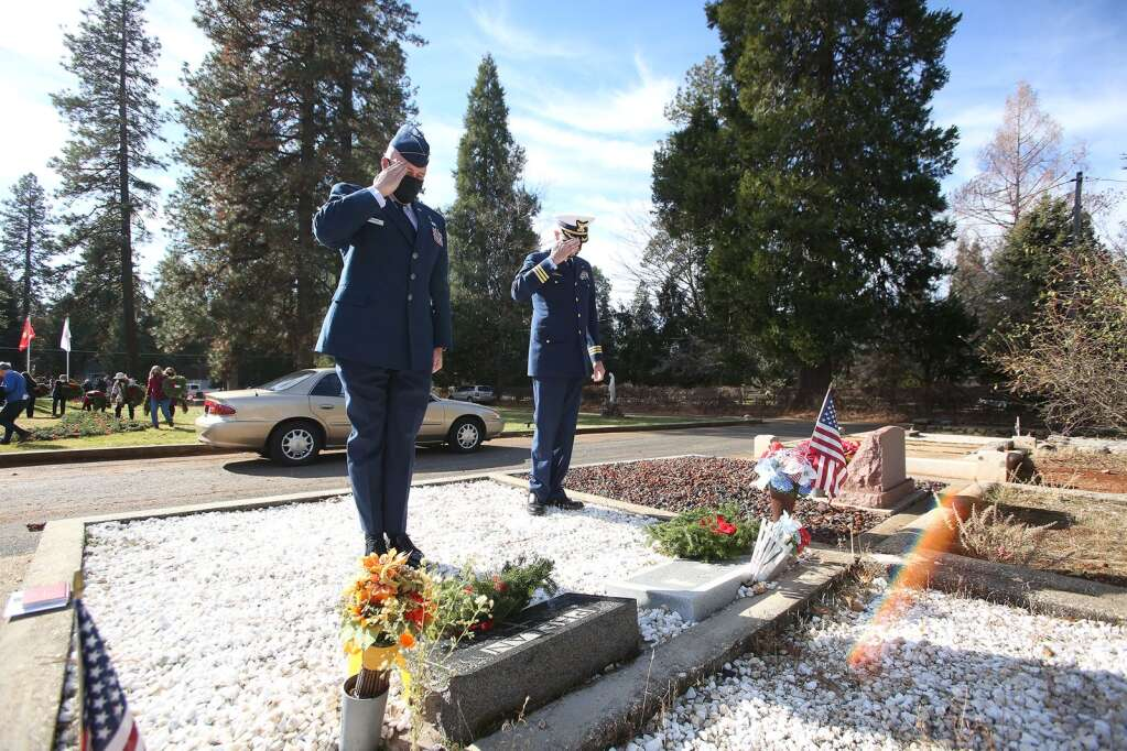 U.S. Air Force Chaplian, Captain Patrick Bracken active duty, and U.S. Coast Guard Claude Hessel retired, say the names of Phelan and Bankus as they place wreaths and salute the graves following the Wreaths Across America ceremony Dec. 20. | Photo: Elias Funez