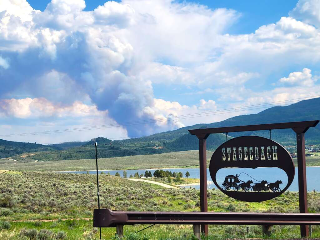 The Muddy Slide Fire creates a large smoke plume June 21 that could be seen for miles, here near Stagecoach Reservoir. (Photo by Dylan Anderson)