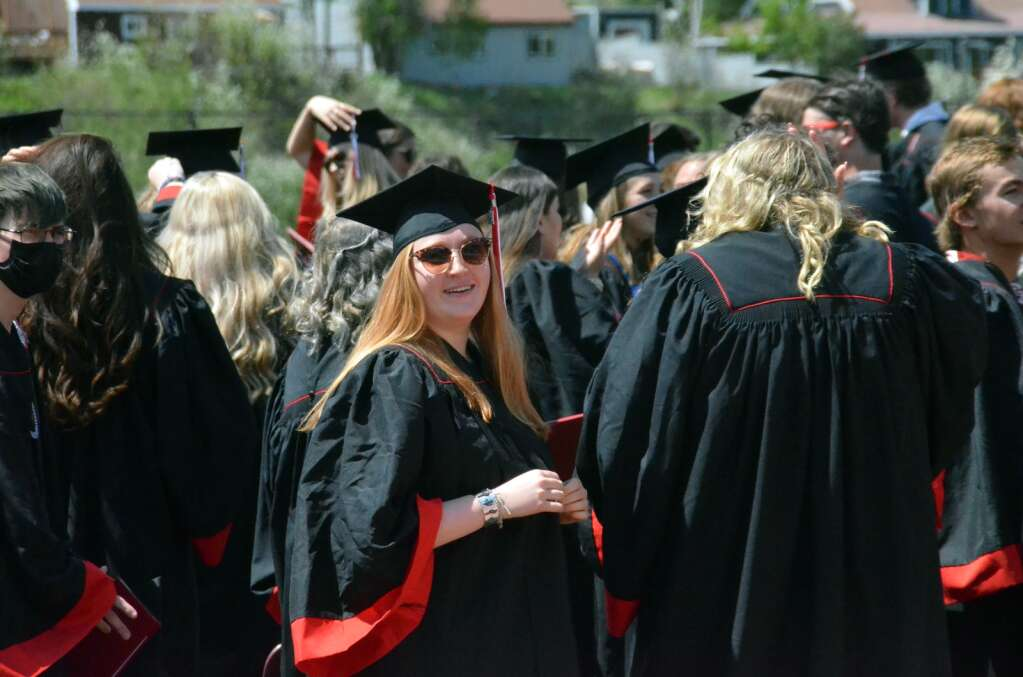 Zoe Welch smiles to the crowd after moving her tassel to officially recognize that she's graduated. (Photo by Bryce Martin)