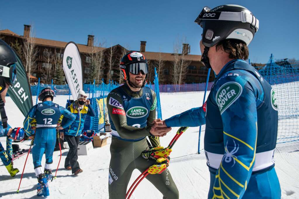 American alpine skier Thomas Biesemeyer and Jared Goldberg congratulate each other after tying for first place during the Men's Downhill National Championships at Aspen Highlands on Saturday, April 10, 2021.This was Biesemeyer's first gold in a downhill national championship. (Kelsey Brunner/The Aspen Times)