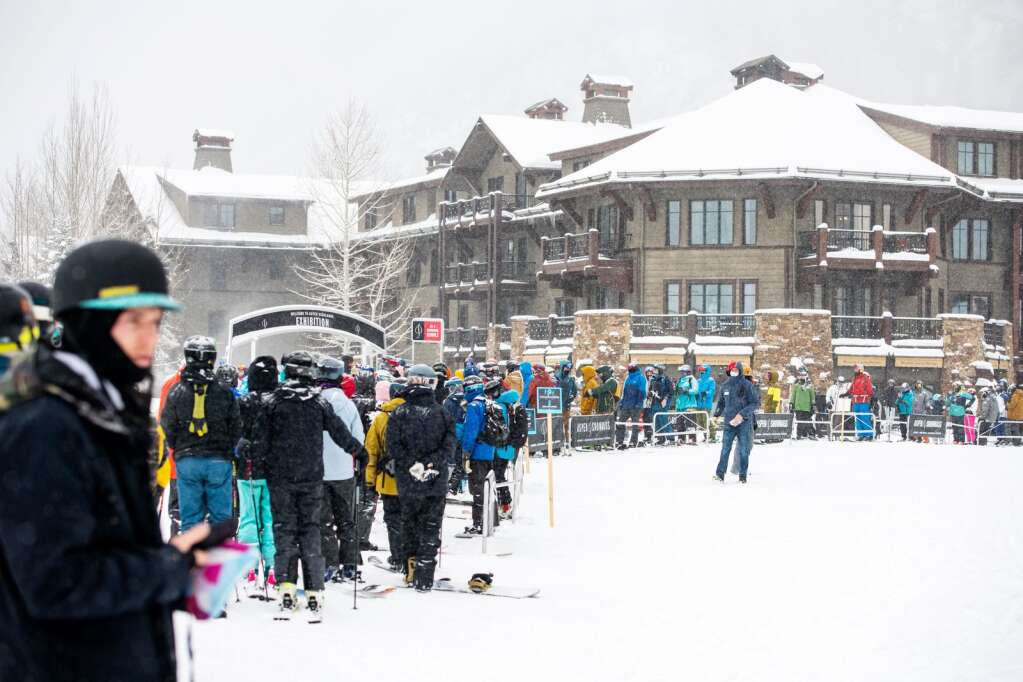 A line of skiers and snowboarders snakes around on opening day of the 2020-21 season at Aspen Highlands on Friday, Dec. 18, 2020. (Kelsey Brunner/The Aspen Times)