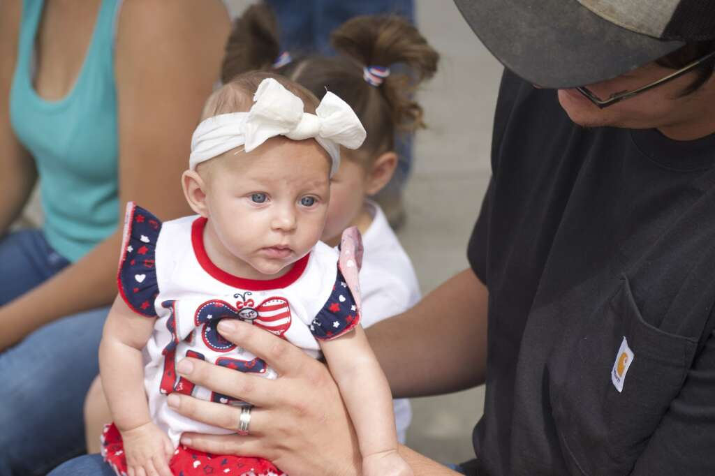 Kennedy Cozzens endures a photo as Craig's Fourth of July parade, held July 5, 2021, marched down Victory Way Monday morning. | Cuyler Meade / Craig Press