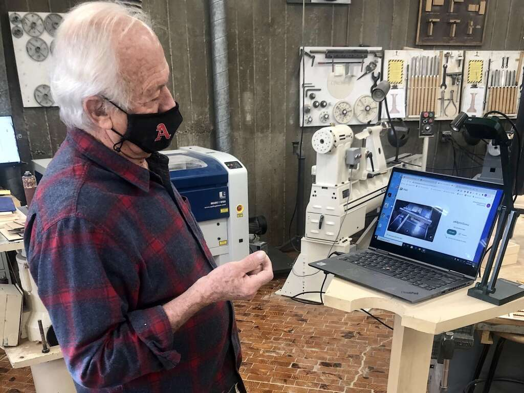 John Fisher sets up the online portal for a laser engraving class at Aspen High School on March 22, 2021. | Kaya Williams/The Aspen Times