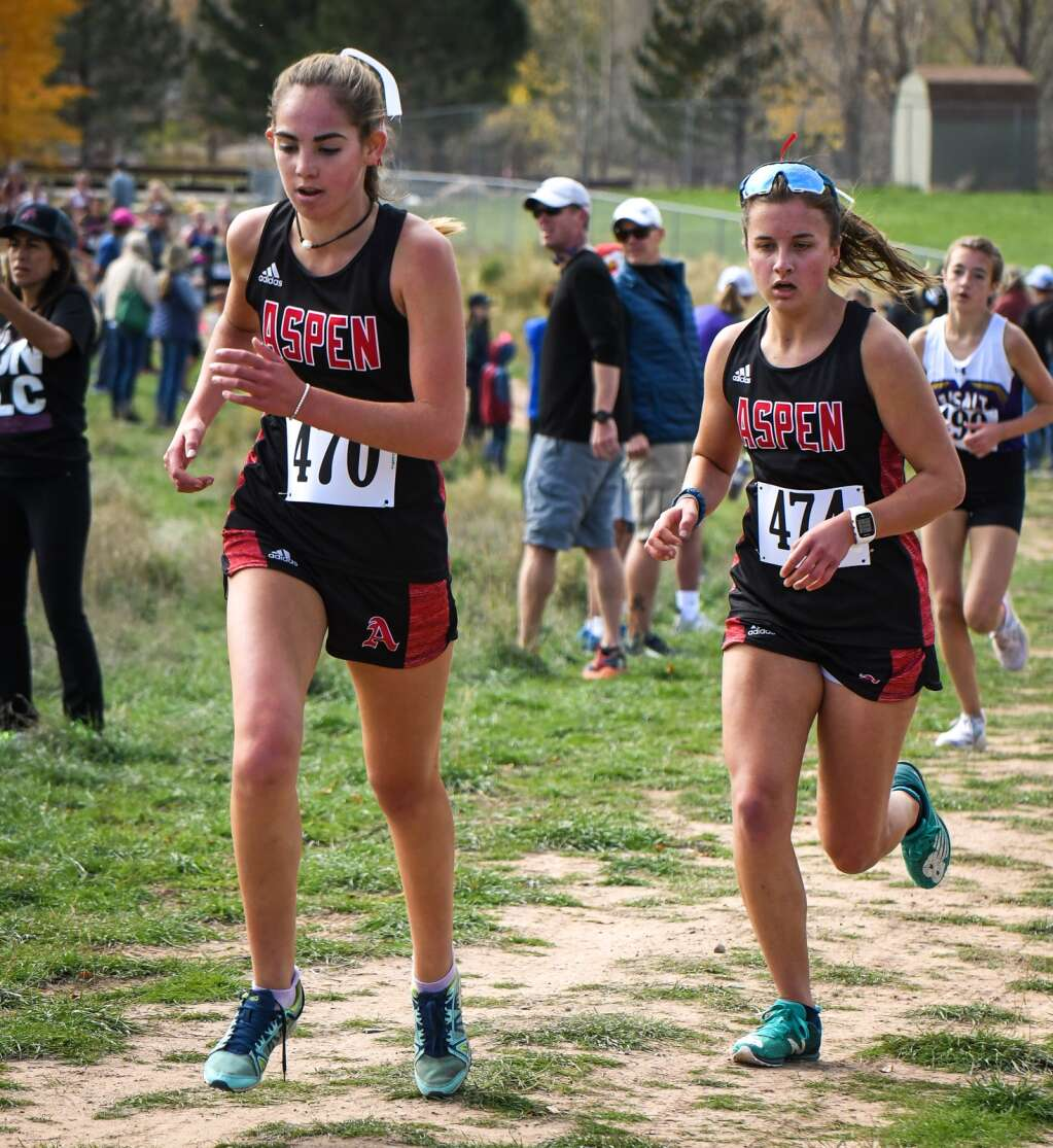Aspen High School's Michaela Kenny, left, and Elsie Weiss compete in the Colorado 3A Region 1 XC meet at VIX Park in New Castle on Friday afternoon.  Chelsea Self/Post Independent