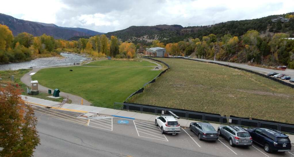 The former Pan and Fork site will be transformed this year. The riverside park, left, will be expanded into the foreground on right. A commercial and residential development will take shape in the right background. The view is from Midland Avenue. | Aspen Times file