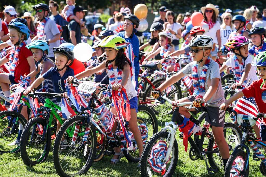 Kids take part in their own bike parade during the Fourth of July celebration in Aspen on Sunday, July 4, 2021, in downtown Aspen. Photo by Austin Colbert/The Aspen Times.