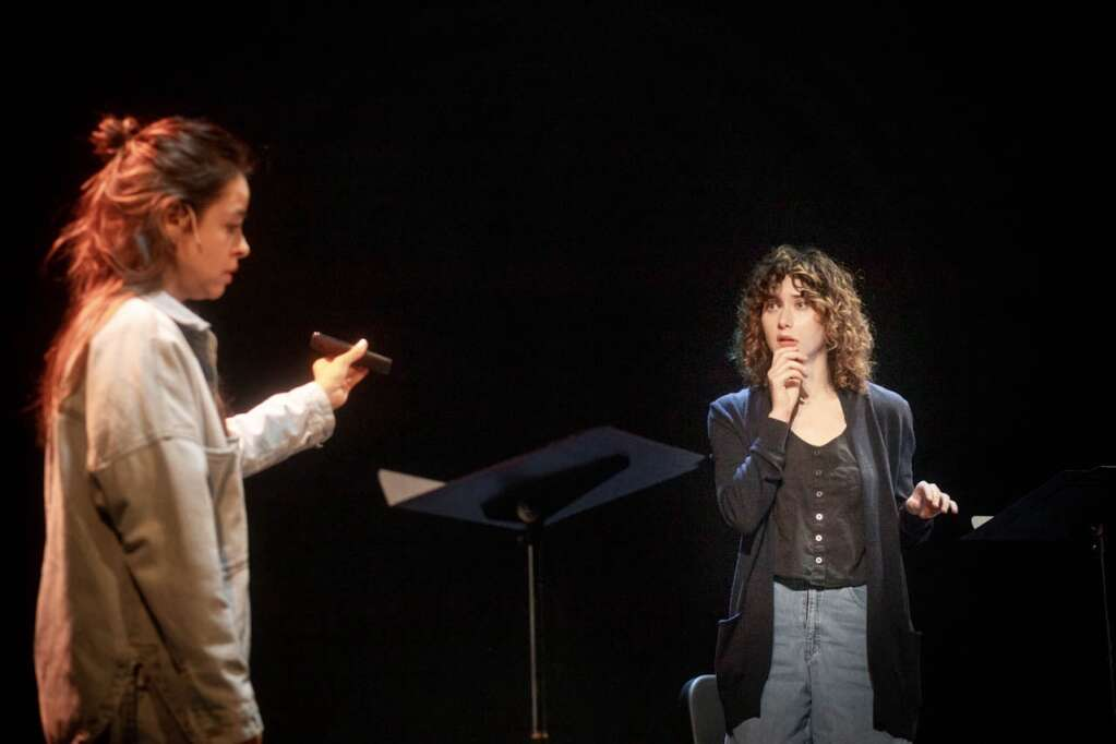 Emma Ramos (left) and Kate Abbruzzese work on a reading of