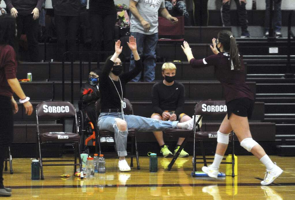 Soroco junior Irene Hoff high fives injured senior Makinley Parker during a game against Hayden on Saturday afternoon. (Photo by Shelby Reardon)