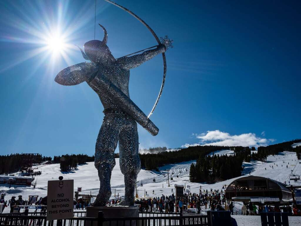 A new statue of Ullr, said to be the god of skis and the bow in Norse mythology, stands at the base of Peak 8 on opening day at Breckenridge Ski Resort on Nov. 13. | Photo by Liz Copan / Studio Copan