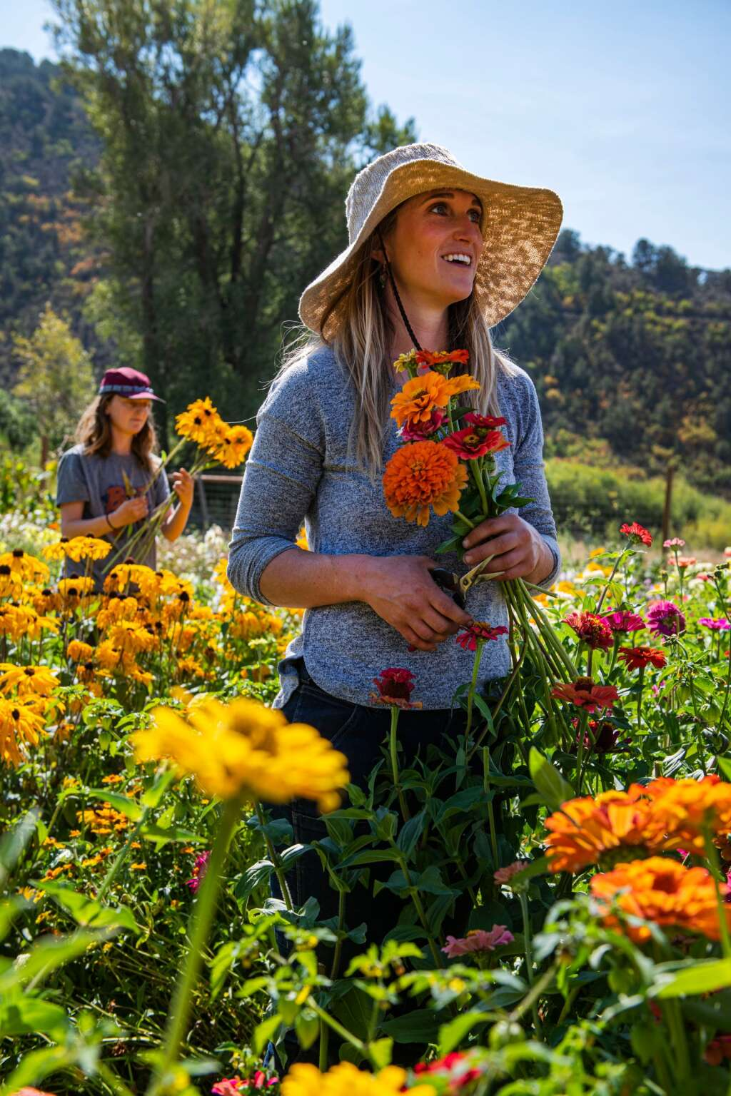 Harper Kaufman, right, and Dara Unger pick flowers in the field at Two Roots Farm in Emma on Friday, Sept. 17, 2021. (Kelsey Brunner/The Aspen Times)