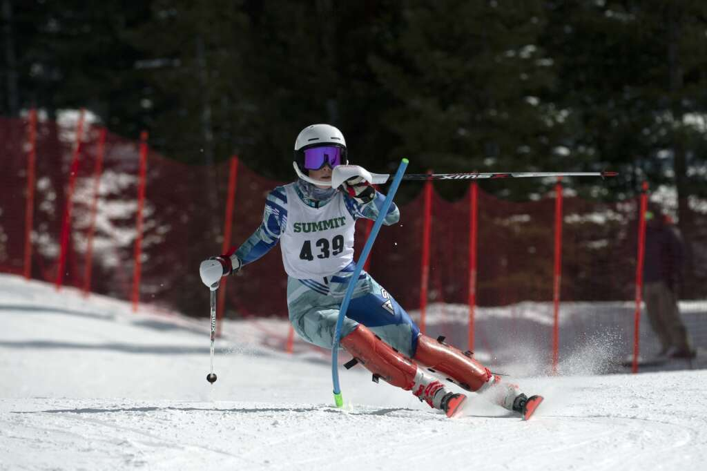 Summit High School Alpine ski team racer Ella Snyder navigates gates while skiing the slalom course during the Colorado High School State Alpine Ski Championships at Loveland Ski Area on Friday, March 12, 2021.   Photo by Jason Connolly / Jason Connolly Photography