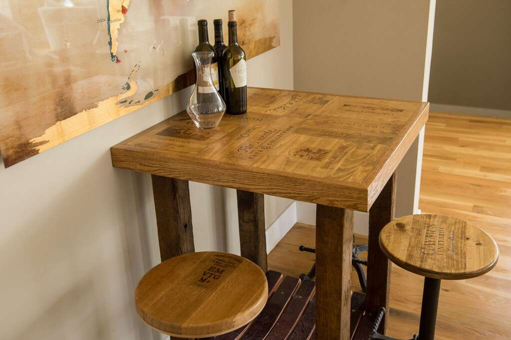 The collection of wooden creations from the artists at Alpine Wine Design includes tables and stools made from old wine barrels and boxes. | Courtesy photo
