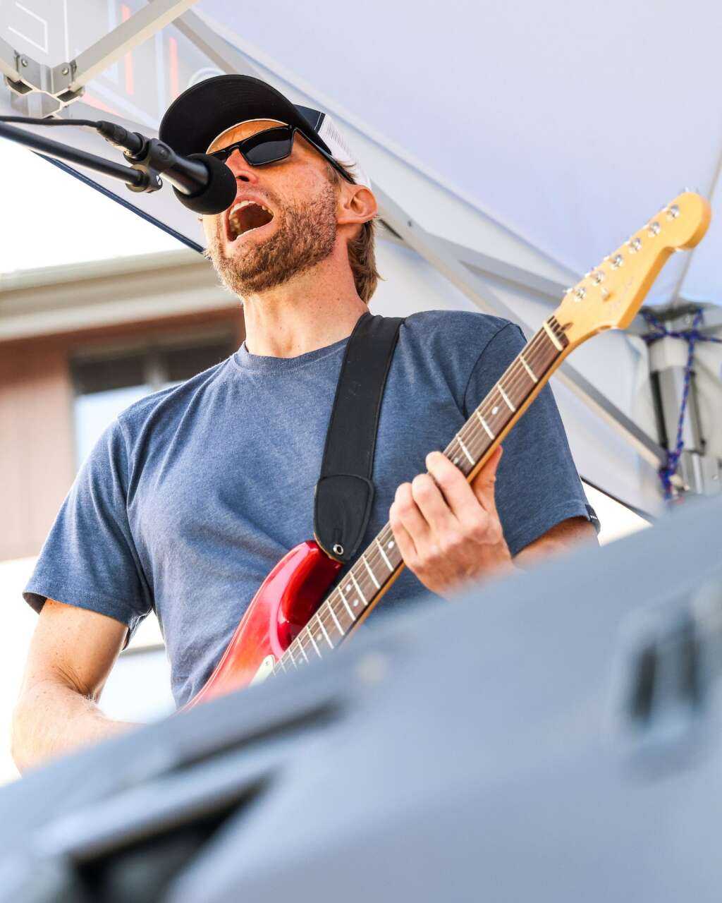 Andy Gunion of the Snowmass-based band Nearly Now performs in front of The Collective on Saturday, July 10, 2021, in Snowmass Base Village. Photo by Austin Colbert/The Aspen Times.