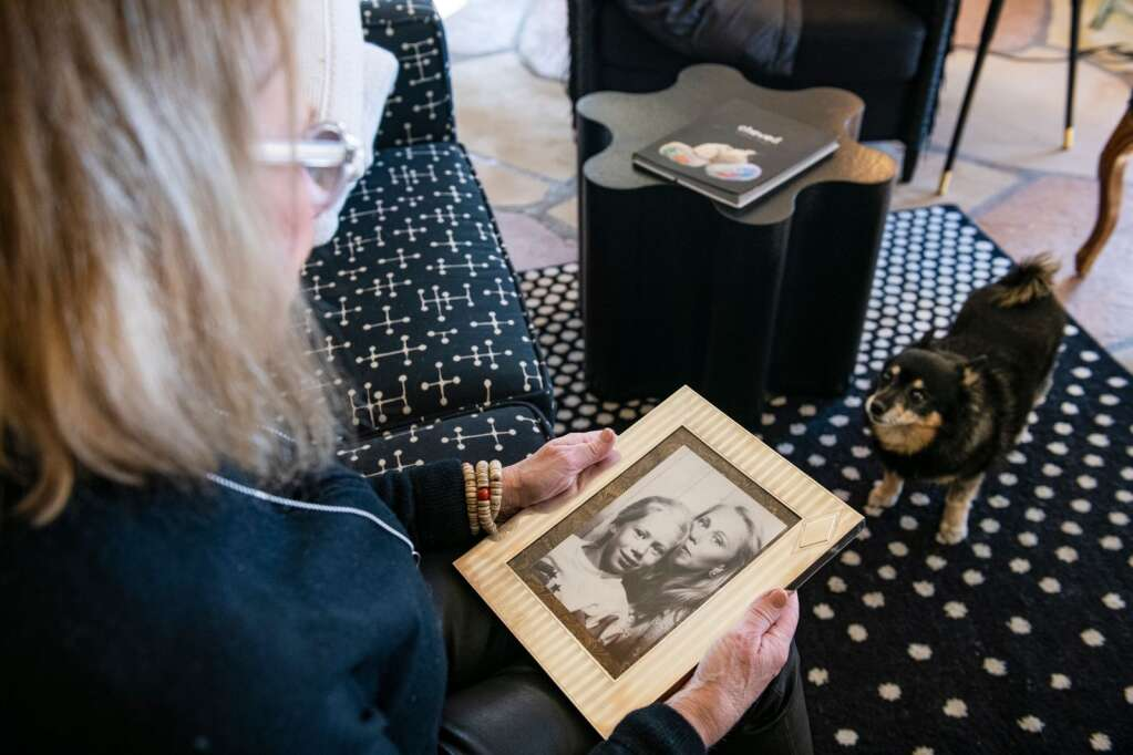 Jackie Long holds a framed photograph of her and her daughter Callie at her home in Aspen on Thursday, Dec. 31, 2020. (Kelsey Brunner/The Aspen Times)