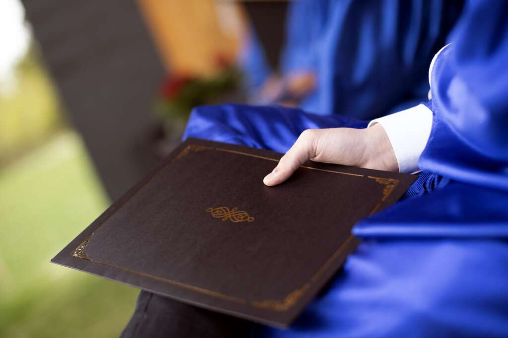 A graduate holds their diploma during the Snowy Peaks High School graduation Wednesday, May 26, at the Silverthorne Performing Arts Center in Silverthorne.   Photo by Jason Connolly / Jason Connolly Photography