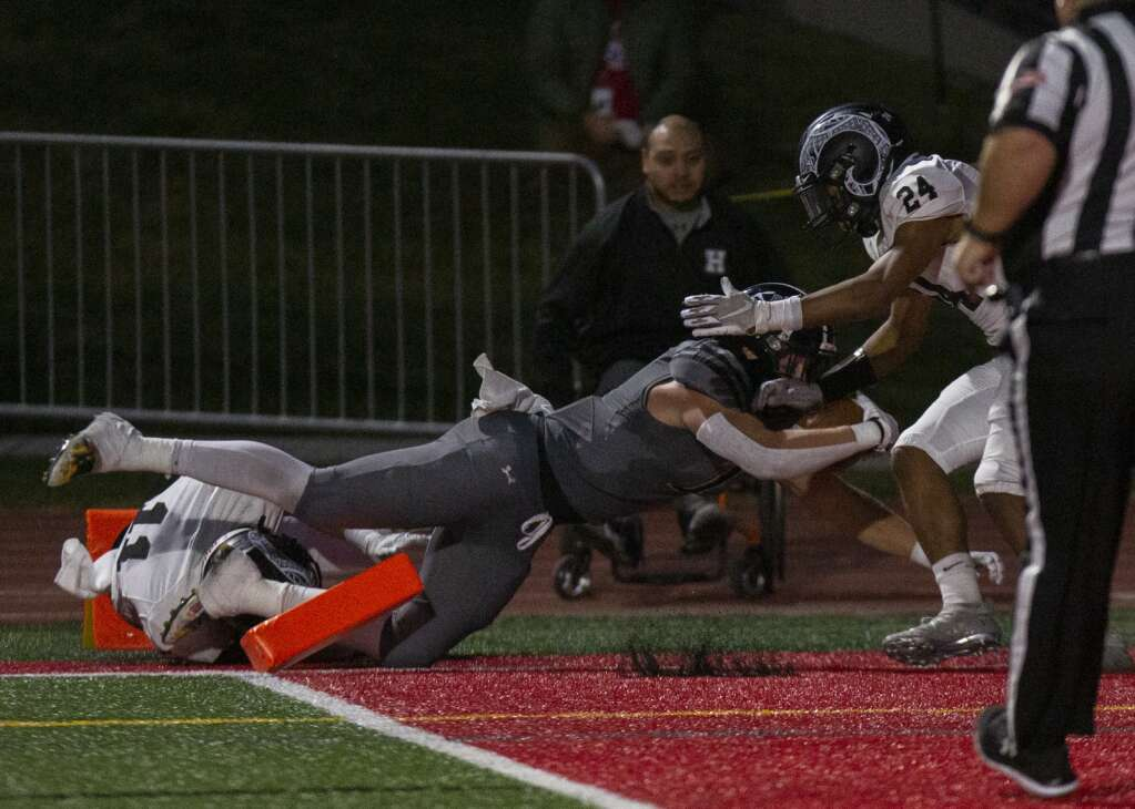 Park City High School's Carson Tabaracci (2) lunges into the end zone, scoring another touchdown for the Miners during their homecoming matchup against Highland High School at Dozier Field Friday evening, Sept. 17, 2021. The Miners defeated the Rams 41-6. (Tanzi Propst/Park Record)