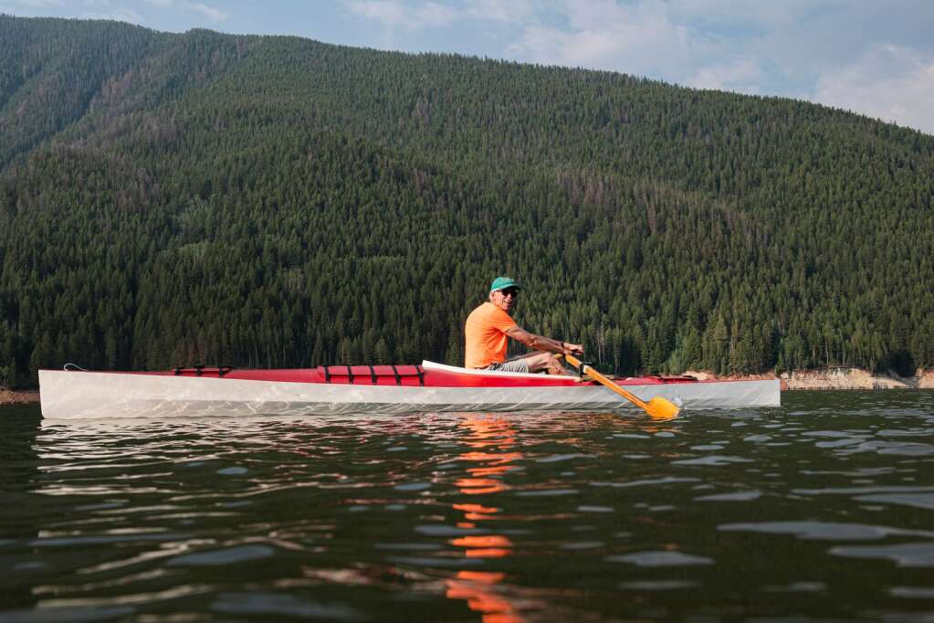Steve Prudden pulls himself along in his boat while rowing on Ruedi Reservoir at 7:30 a.m. on Tuesday, July 13, 2021. (Kelsey Brunner/The Aspen Times)