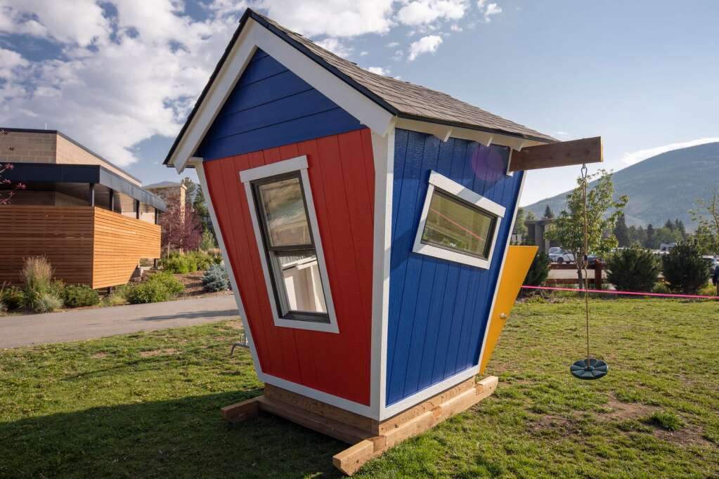The Crooked House for the Playhouse Project sits at Marina Park in Dillon on Friday, Aug. 6. The house was built by Travis Construction.   Photo by Tripp Fay / Tripp Fay Photography