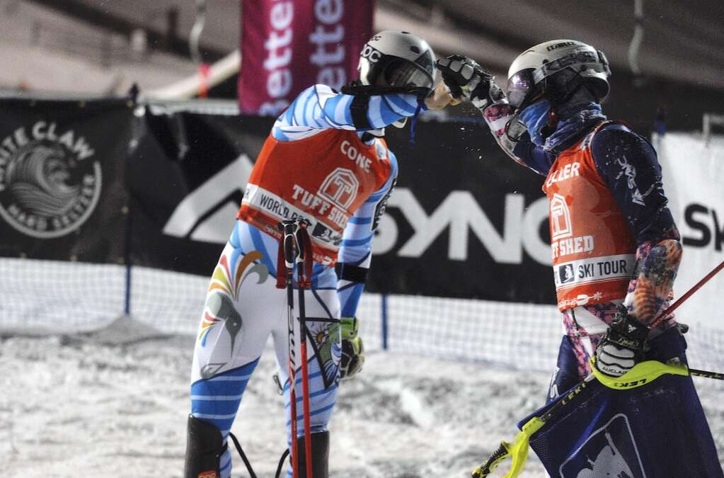 Winner Robert Cone and second-place finisher Garret Driller fist bump at the finish line during the World Pro Ski Tour at Howelsen Hill on Saturday night. (Photo by Shelby Reardon)
