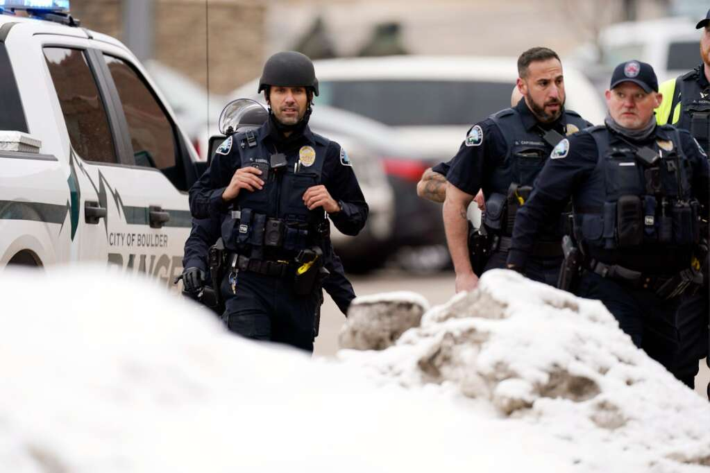 Police outside a King Soopers grocery store where a shooting took place Monday, March 23, 2021, in Boulder, Colo.  (AP Photo/David Zalubowski)