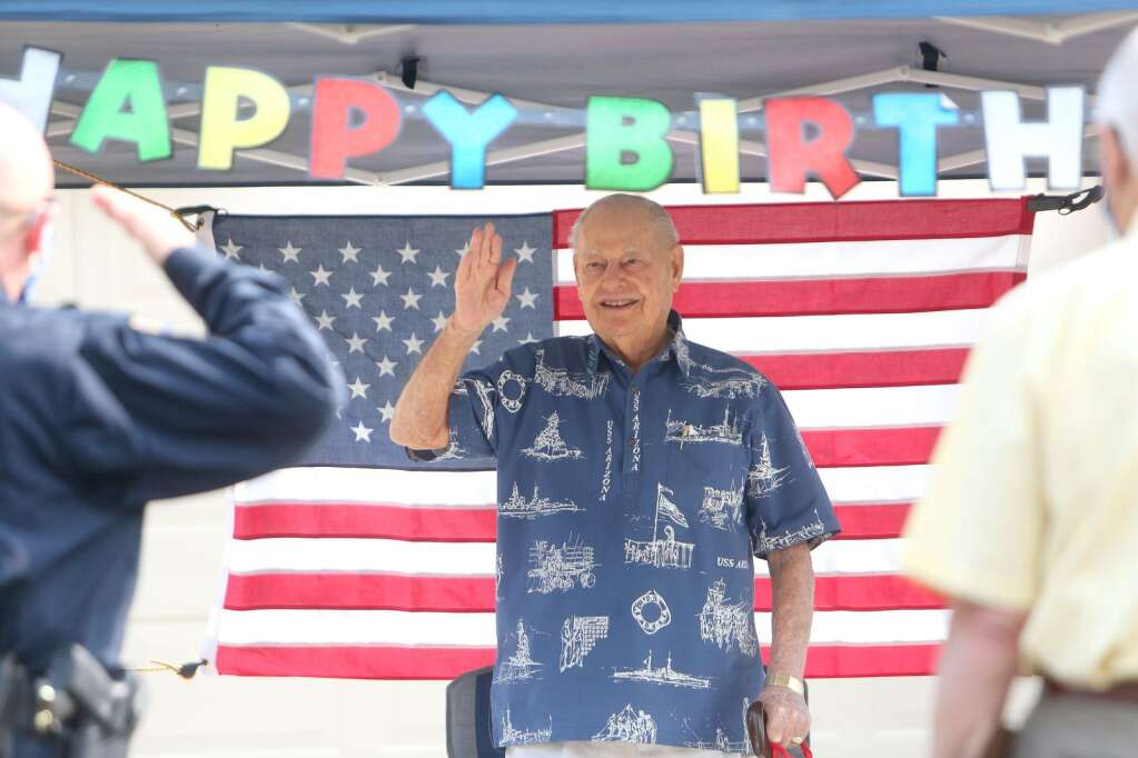 WWII Veteran and USS Arizona survivor Lou Conter was given a hero's birthday salute Saturday morning Sept. 12 in front of his home at Grass Valley's Eskaton Village. The 99 year old Conter was greeted by hundreds that drove by in their vehicles to wish the hero happy birthday. | Photo: Elias Funez