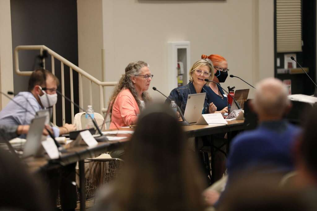 Members of the Colorado Redistricting Commission speak with community members during a hearing on Saturday, July 31, 2021 in Frisco. The hearing provided Coloradans a chance to voice their input for preliminary map drawings. | Photo by Ashley Low / Ashley Low Photography