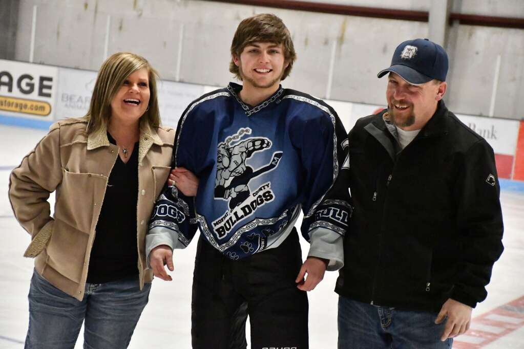 Clay Durham with his parents Saturday night during the Senior Night ceremony. (Andy Bockelman / For Craig Press)